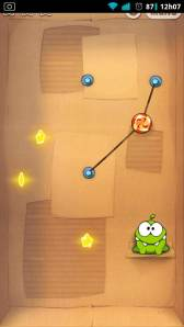 Barra de notificações visível sobre o Cut the Rope